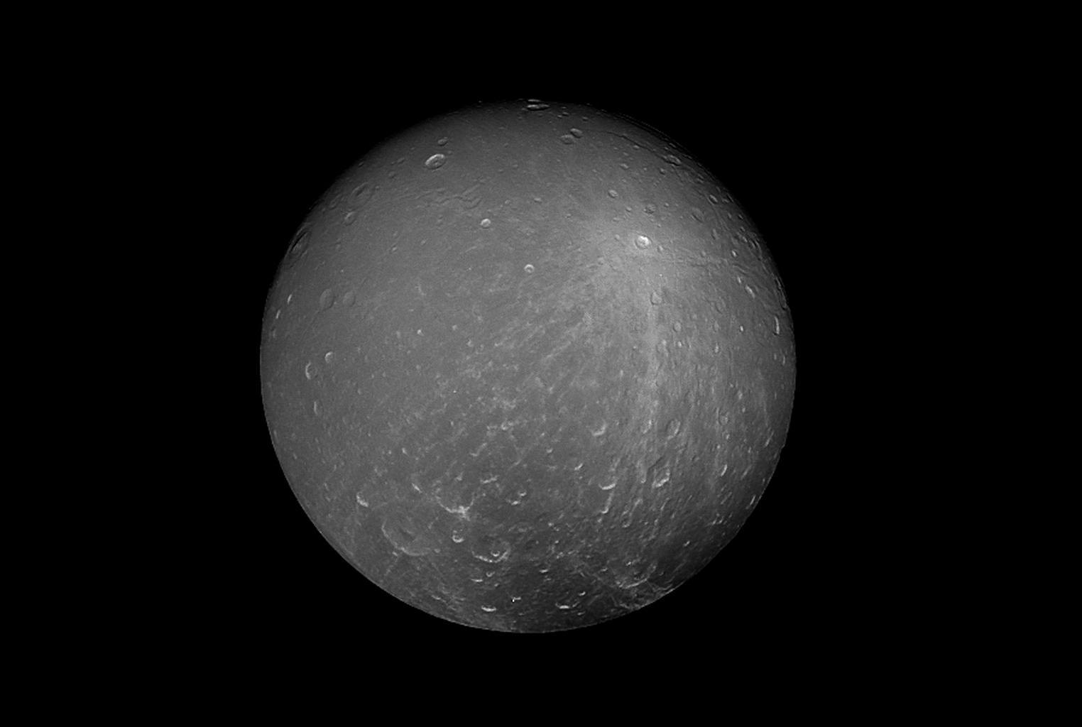 NASA's Cassini spacecraft captured this striking view of Saturn's moon Dione on July 23, 2012. Its density suggests that about a third of the moon is made up of a dense core (probably silicate rock) with the remainder of its material being water ice.