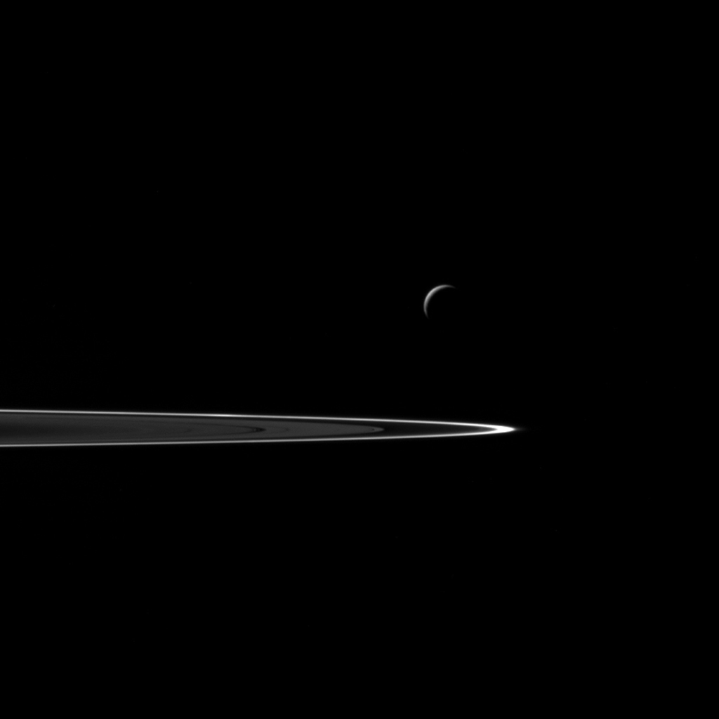 Following a successful close flyby of Enceladus, NASA's Cassini spacecraft captured this artful composition of the icy moon with Saturn's rings beyond.