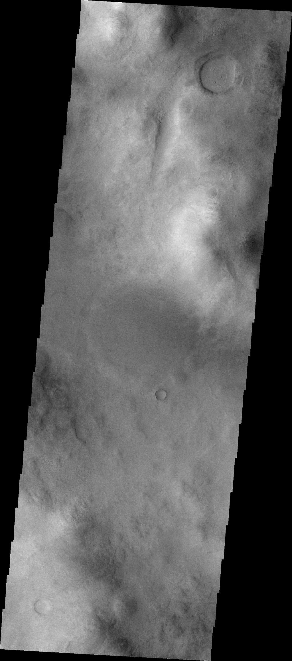 Do you see what I see this image from NASA's Mars Odyssey spacecraft? Turn your head to the left and look at the crater at the top of the image - a smiley face will be gazing at you.