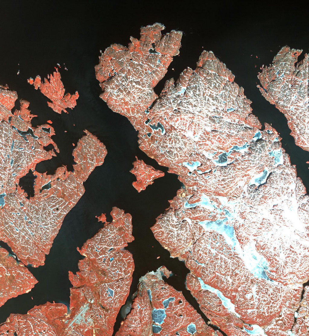 This image from NASA's Terra spacecraft shows the town of Kirkenes in northernmost Norway, with its 3400 inhabitants, as they prepare for an expected boom as a shipping hub, as global warming has led to the opening up of the Northern Sea Route.