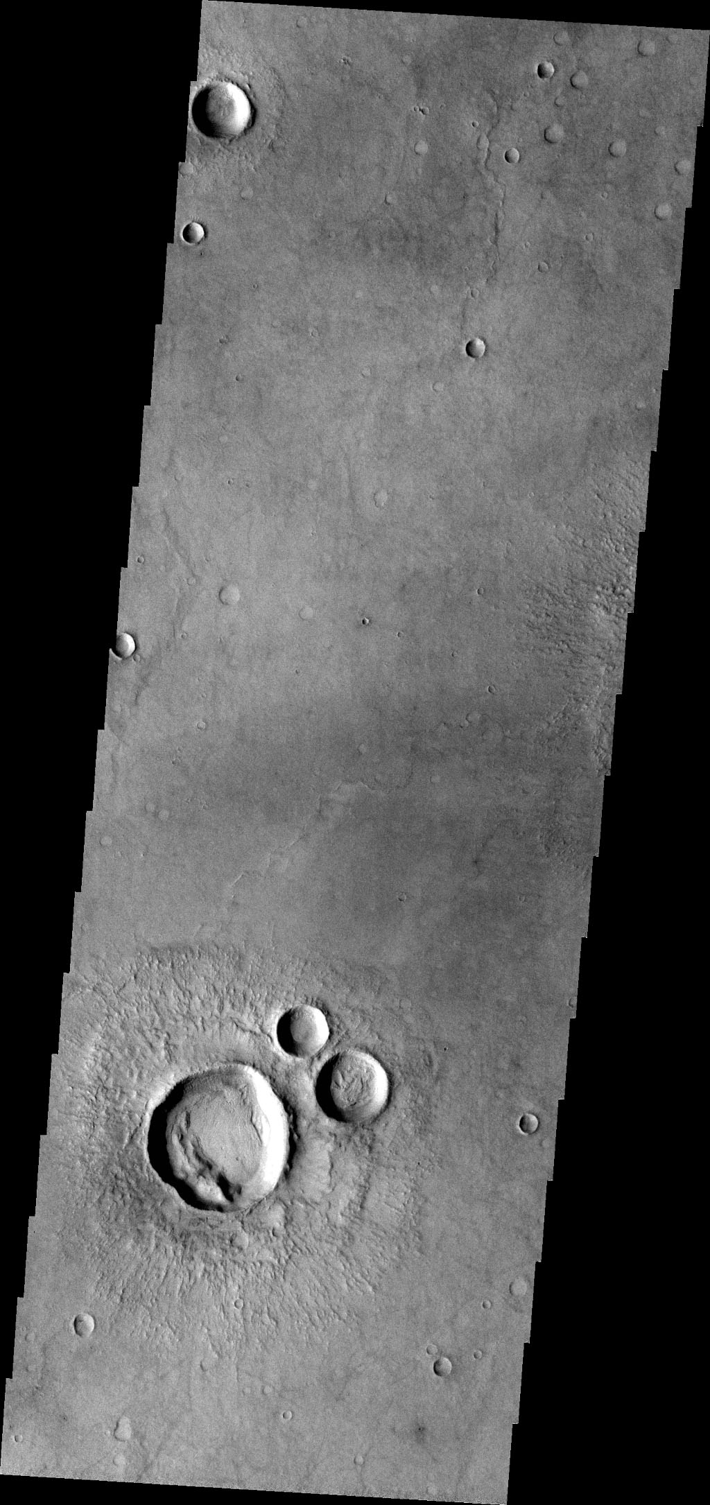 Do you see what I see in this image from NASA's Mars Odyssey spacecraft? The group of craters at the bottom of the image look like a muppet.