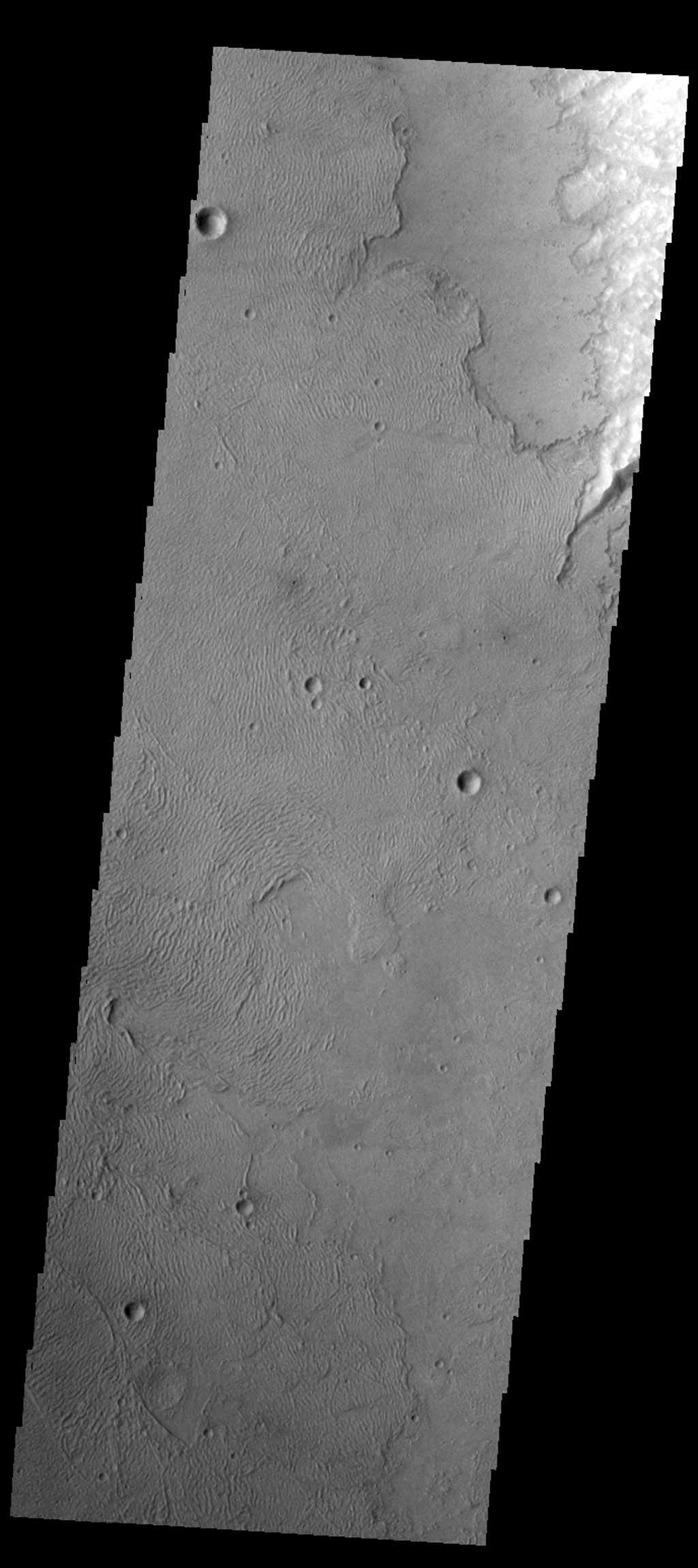 The volcanic flows in this image from NASA's Mars Odyssey spacecraft are at the far southwestern margin of Daedalia Planum on Mars.