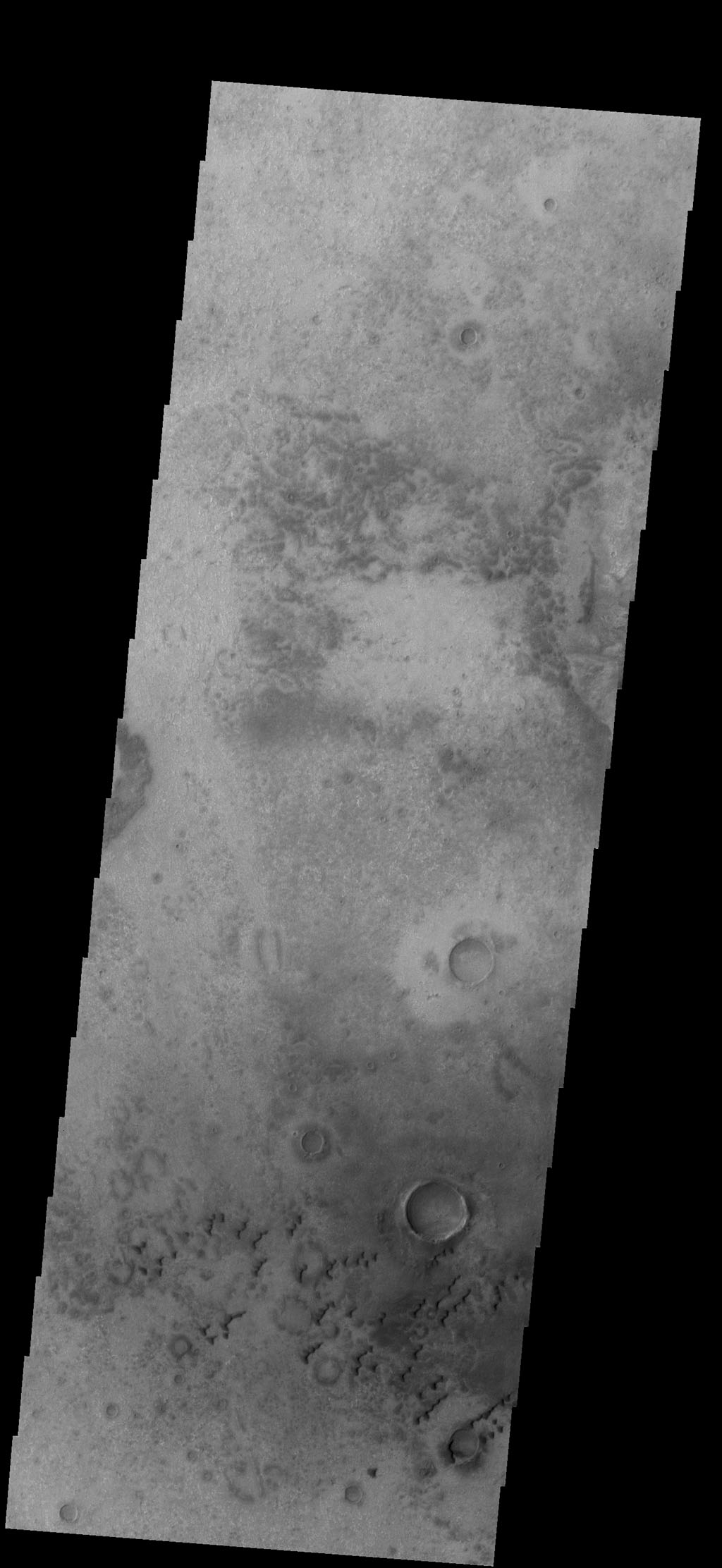 This image from NASA's 2001 Mars Odyssey spacecraft shows small sets of dunes on the plains of Aonia Terra.