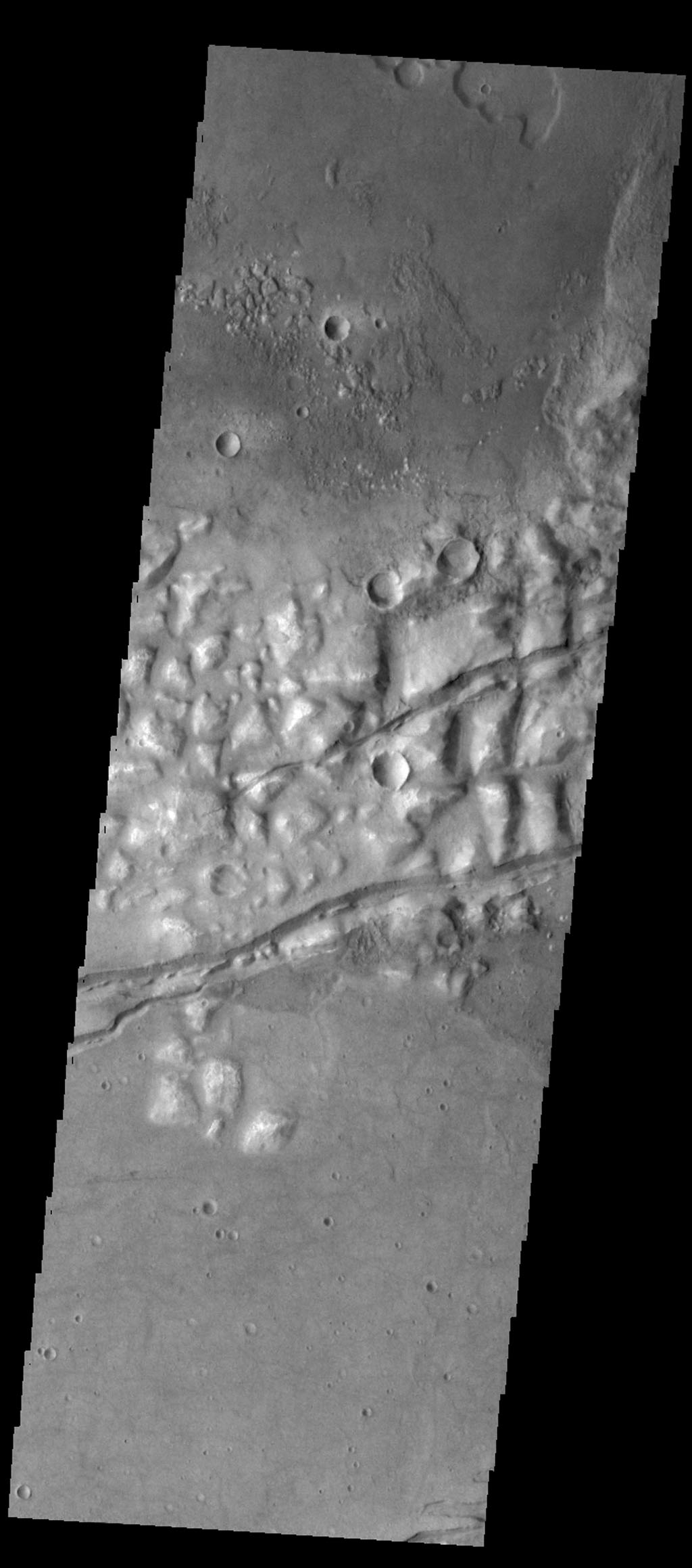 Several fractures cross through Gorgonum Chaos in this image captured by NASA's 2001 Mars Odyssey spacecraft.