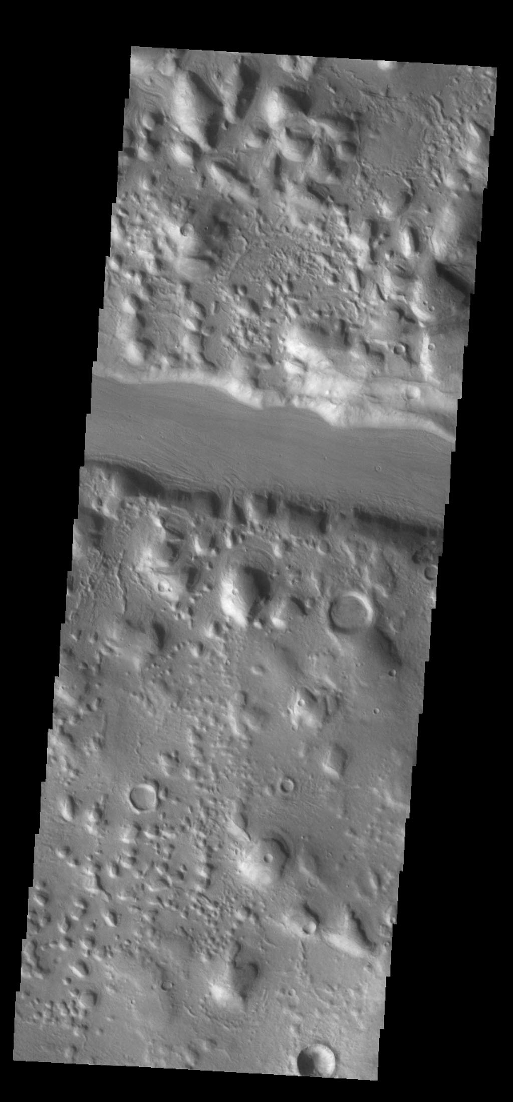 This channel-like feature is actually a large fracture that cuts through a small highlands as seen by NASA's 2001 Mars Odyssey spacecraft.
