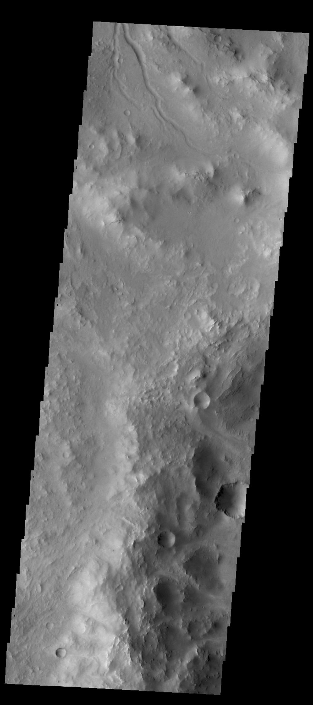 The small channel at the top of this image from NASA's 2001 Mars Odyssey spacecraft is located on the rim of an unnamed crater in Terra Sabaea.