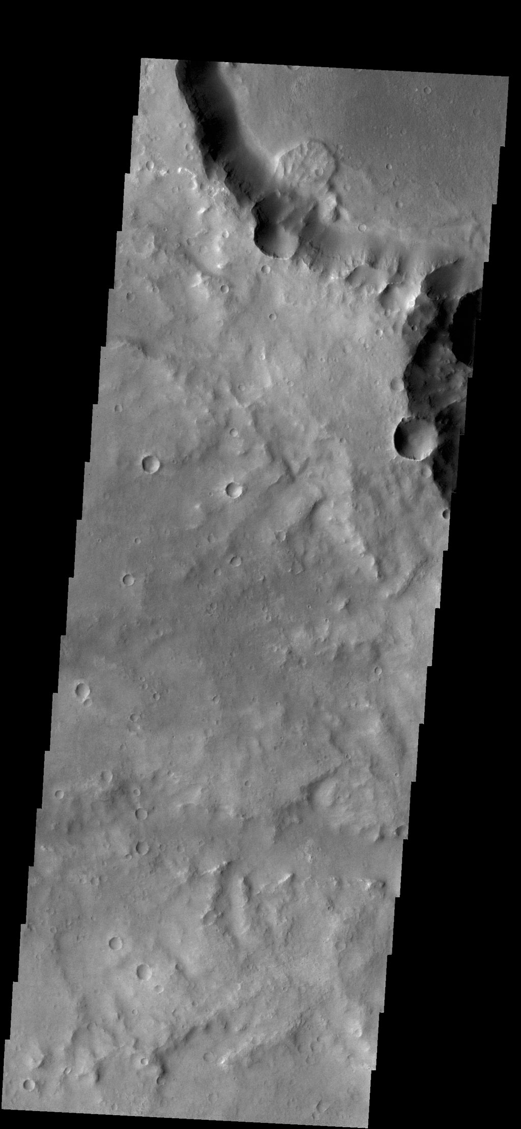 This small landslide deposit is located in an unnamed crater in Margaritifer Terra in this image captured by NASA's 2001 Mars Odyssey spacecraft.