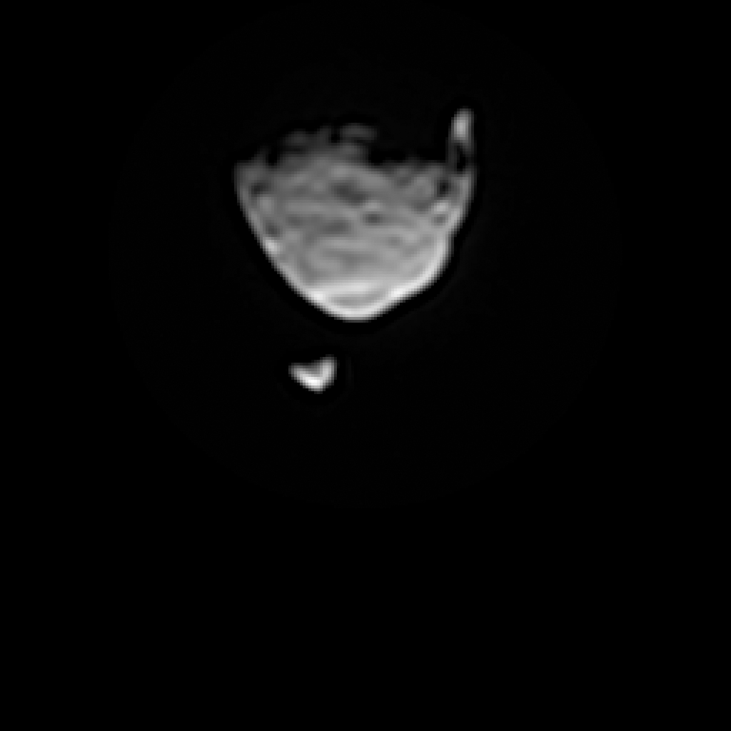 This image from a movie clip shows Phobos, the larger of the two moons of Mars, passing in front of the other Martian moon, Deimos, on Aug. 1, from the perspective of NASA's Mars rover Curiosity.