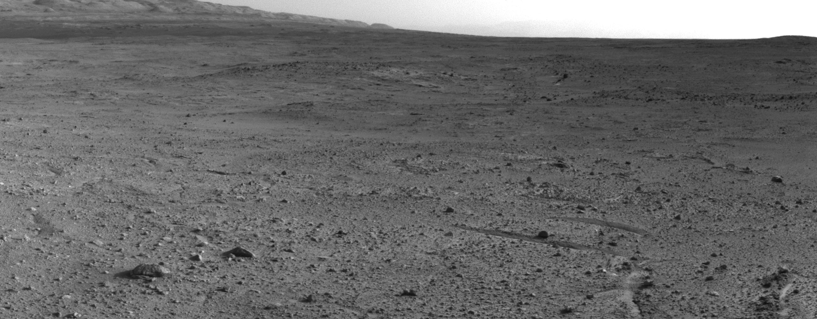 In the upper central portion of this image is a patch of ground paler than its surroundings as seen by NASA's Mars rover Curiosity after reaching the top of a rise called 'Panorama Point.'
