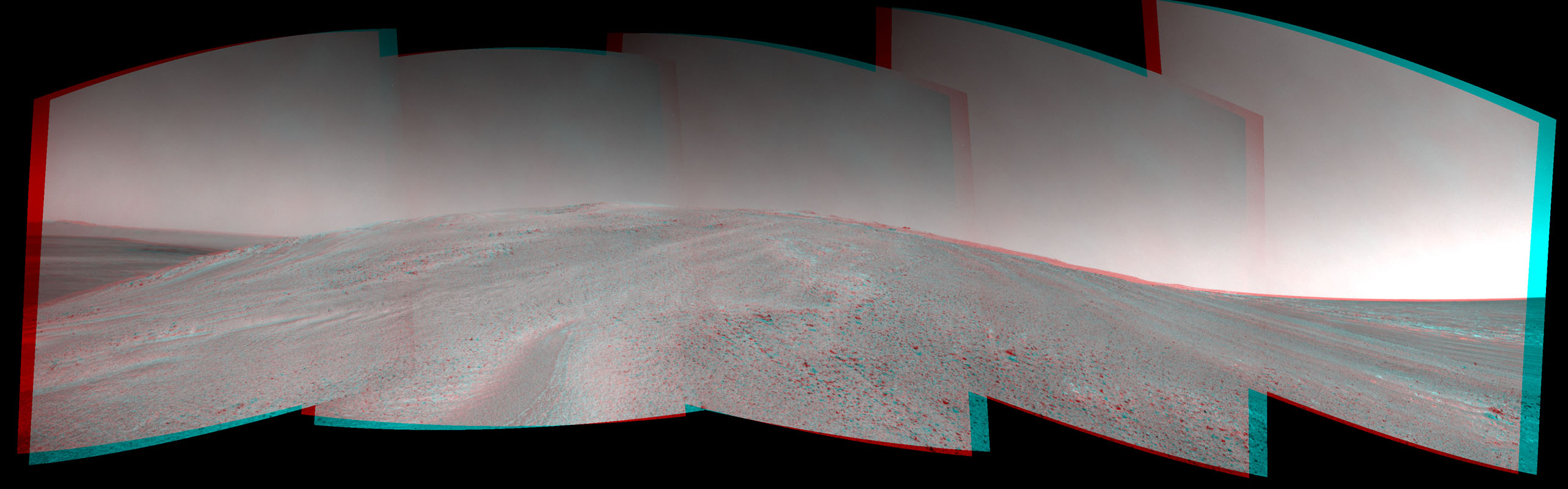 NASA's Mars Exploration Rover Opportunity captured this 3-D view after beginning to ascend the northwestern slope of 'Solander Point' on the western rim of Endeavour Crater.
