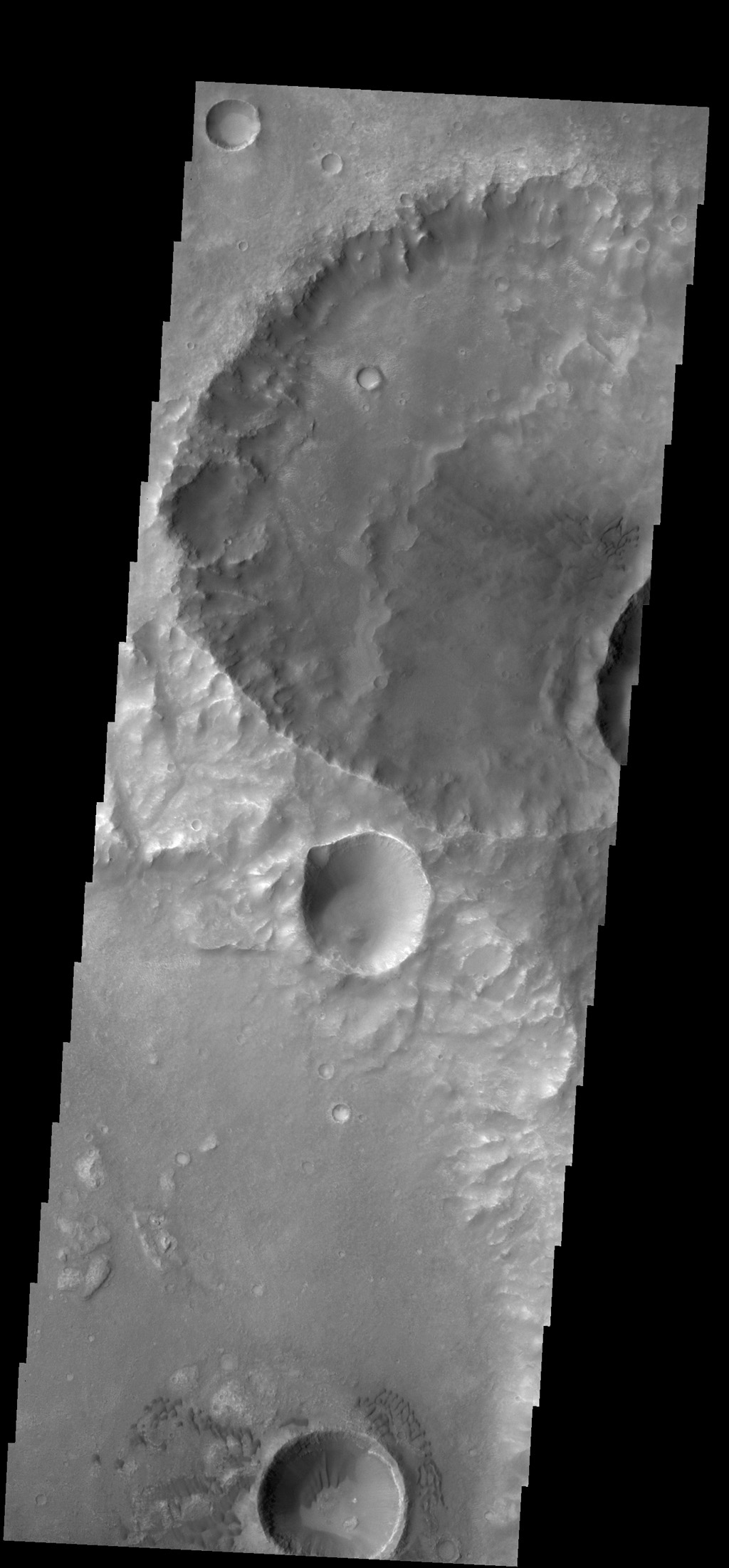 Dunes can be seen in the bottom and upper right central parts this image of Terra Cimmeria on Mars captured by NASA's 2001 Mars Odyssey spacecraft.