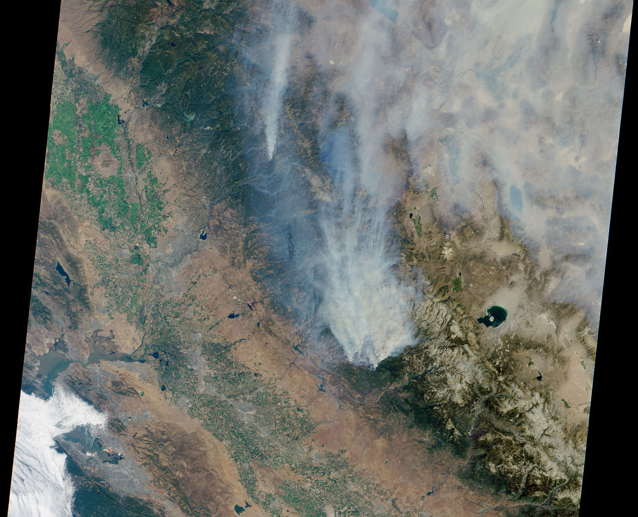 This visible image of California's Rim Fire was acquired Aug. 23, 2013 by the Multi-angle Imaging SpectroRadiometer (MISR) instrument on NASA's Terra spacecraft, showing extensive, brownish smoke.