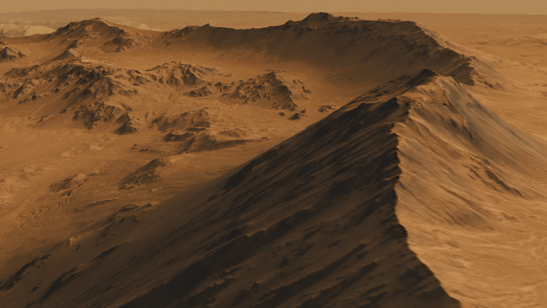 This is a screen shot from a high-definition simulated movie of Mojave Crater on Mars, based on images taken by the High Resolution Imaging Science Experiment (HiRISE) camera on NASA's Mars Reconnaissance Orbiter.