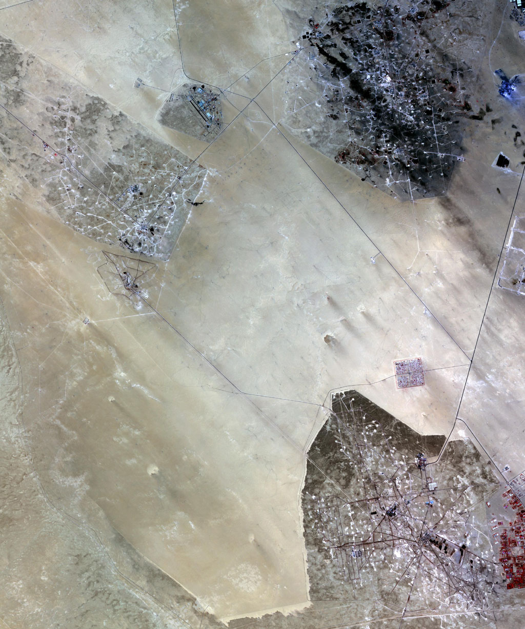 In the desert of southern Kuwait, three oil fields spread out across the empty landscape as seen by NASA's Terra spacecraft.