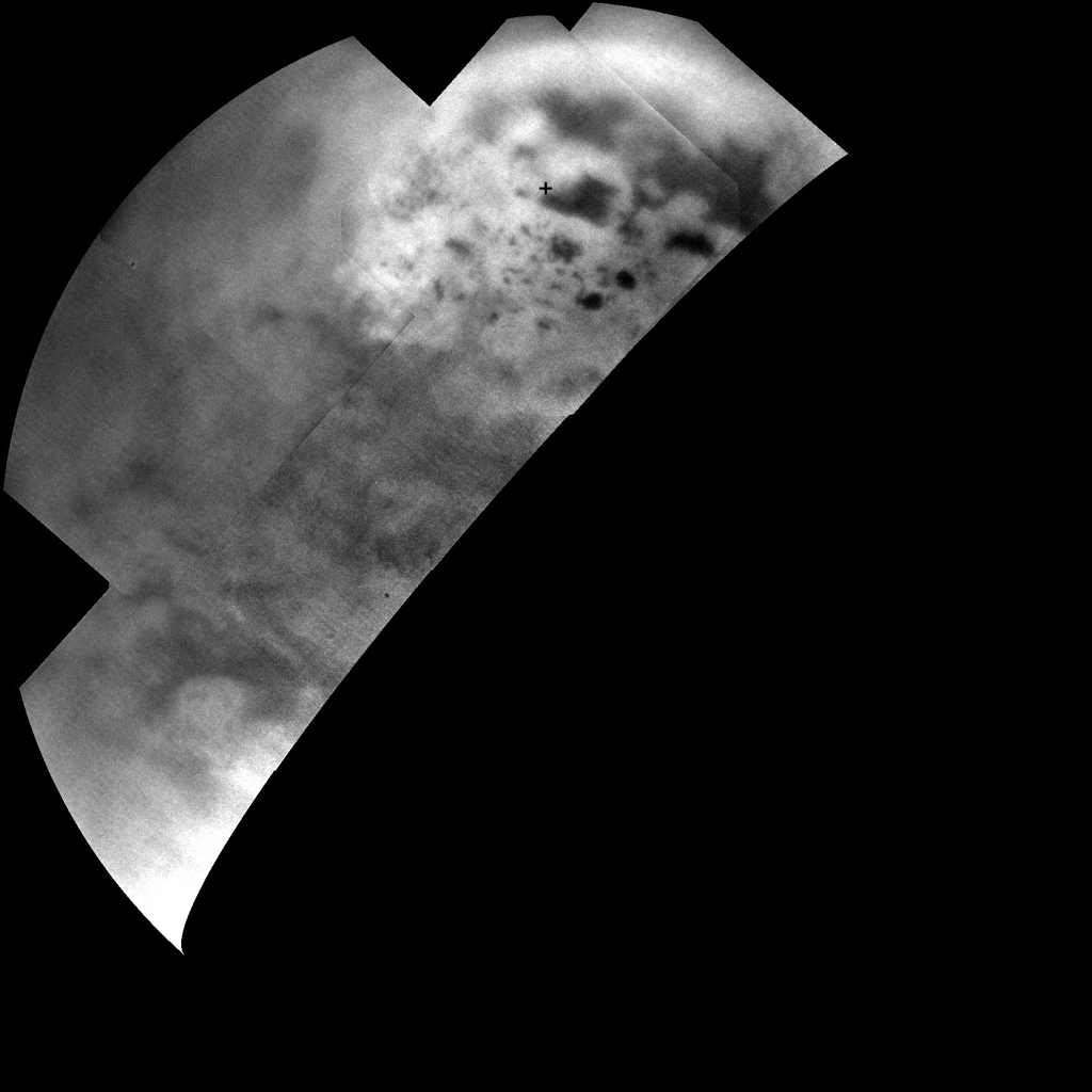 Ultracold hydrocarbon lakes and seas (dark shapes) near the north pole of Saturn's moon Titan can be seen embedded in some kind of bright surface material in this infrared mosaic from NASA's Cassini mission.