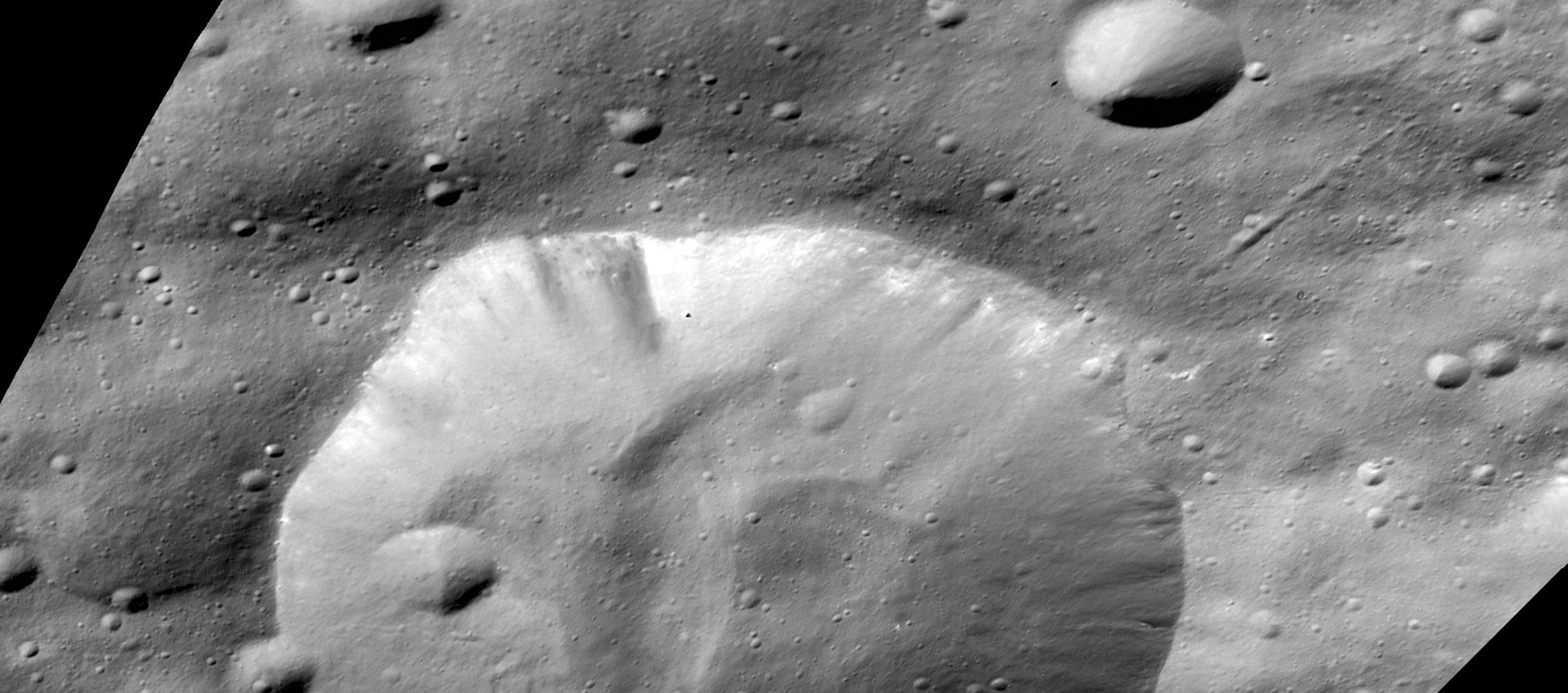 This image from NASA's Dawn mission shows a crater in the northern hemisphere of the giant asteroid Vesta called Bellicia.
