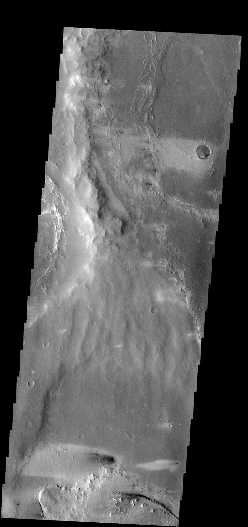 Windstreaks in this image indicate winds from the east to west in this region of Meridiani Planum captured by NASA's 2001 Mars Odyssey spacecraft.