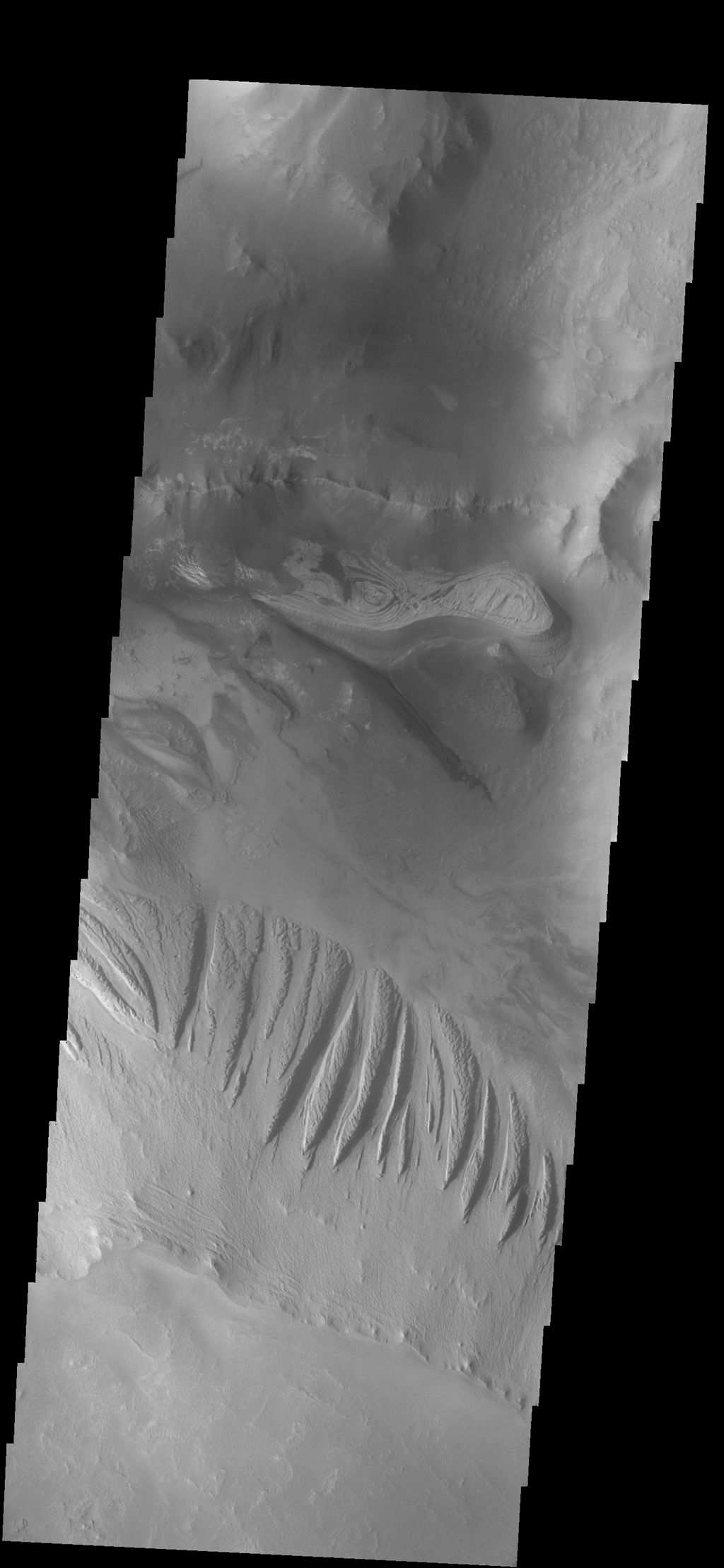 This image shows a portion of Candor Chasma as seen by NASA's 2001 Mars Odyssey spacecraft.