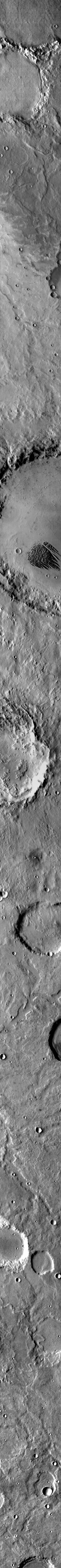 This infrared image, taken by NASA's 2001 Mars Odyssey spacecraft, shows the feature called 'White Rock.' The feature is dark, indicating that it is cooler than the surroundings.