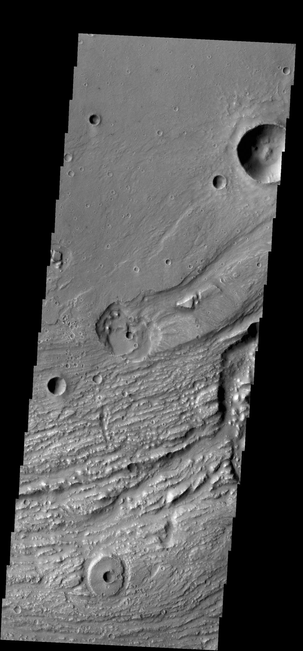 This image shows another portion of Ravi Vallis. In this image taken by NASA's 2001 Mars Odyssey spacecraft, a small crater and the resistant material formed during the impact form a 'donut' on the floor of the valley.