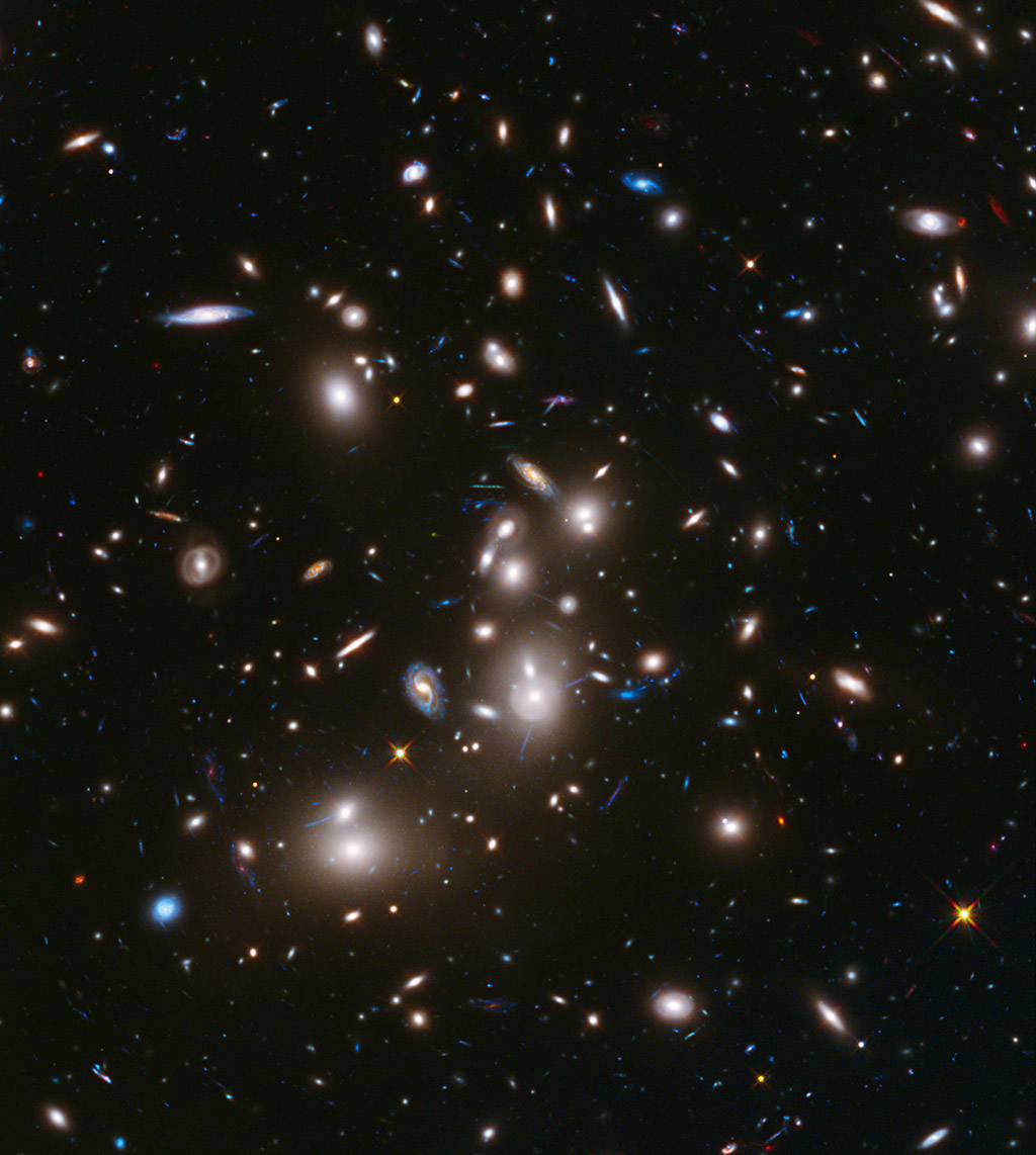 This long-exposure image from NASA's Hubble Space Telescope of massive galaxy cluster Abell 2744 is the deepest ever made of any cluster of galaxies. Shown in the foreground is Abell 2744, located in the constellation Sculptor.