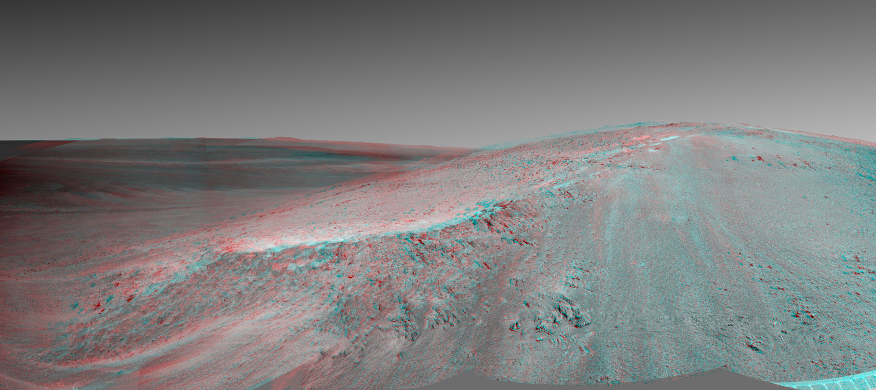This stereo view shows the 'Murray Ridge' portion of the western rim of Endeavour Crater on Mars. You need 3D glasses to view this image from NASA's Mars Exploration Rover Opportunity.