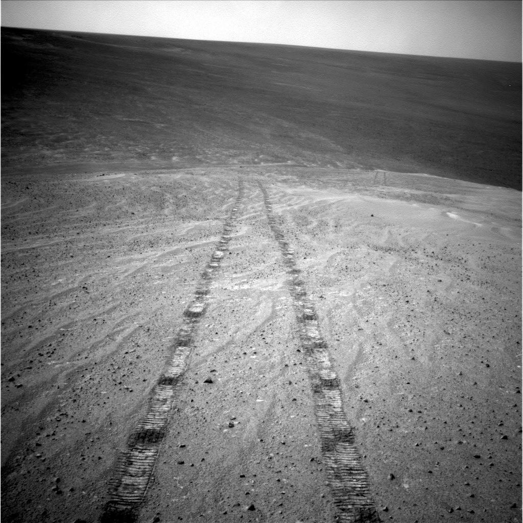on mars day opportunity rover prepares mission into crater