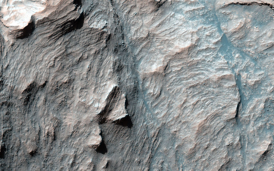 This is only one of four impact craters on Mars known that possesses intact layers exposed in the central uplift in this image from NASA's Mars Reconnaissance Orbiter.