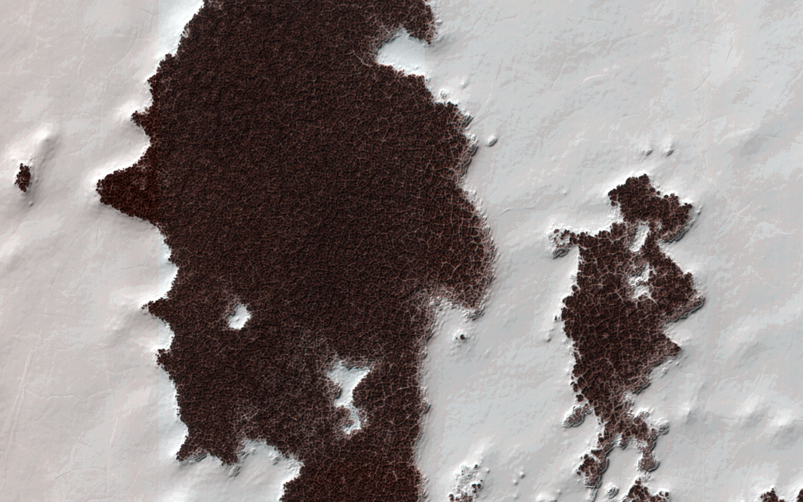 The white portions of this observation are part of the South Polar residual ice cap, with the sunlight is coming from roughly the bottom of this non-map projected image captured by NASA's Mars Reconnaissance Orbiter.