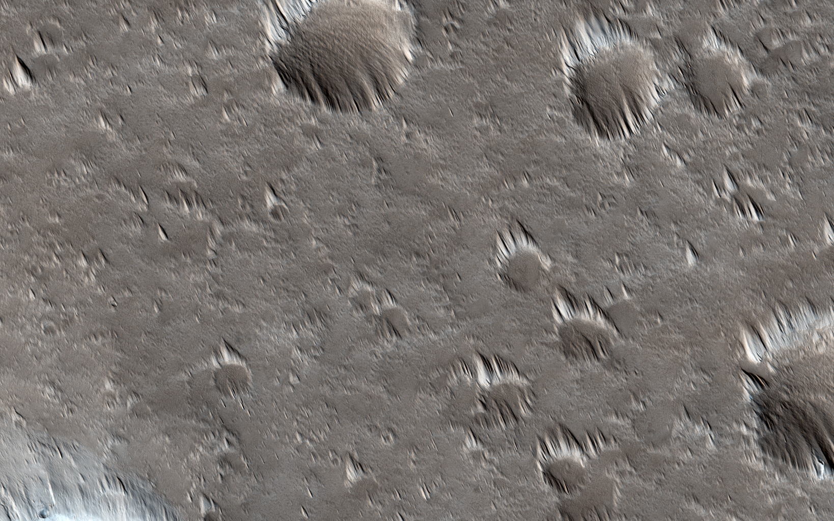 This image captured by NASA's Mars Reconnaissance Orbiter was intended to search for surface changes after three Mars years in a dust-covered region west of the Alba Mons volcano.