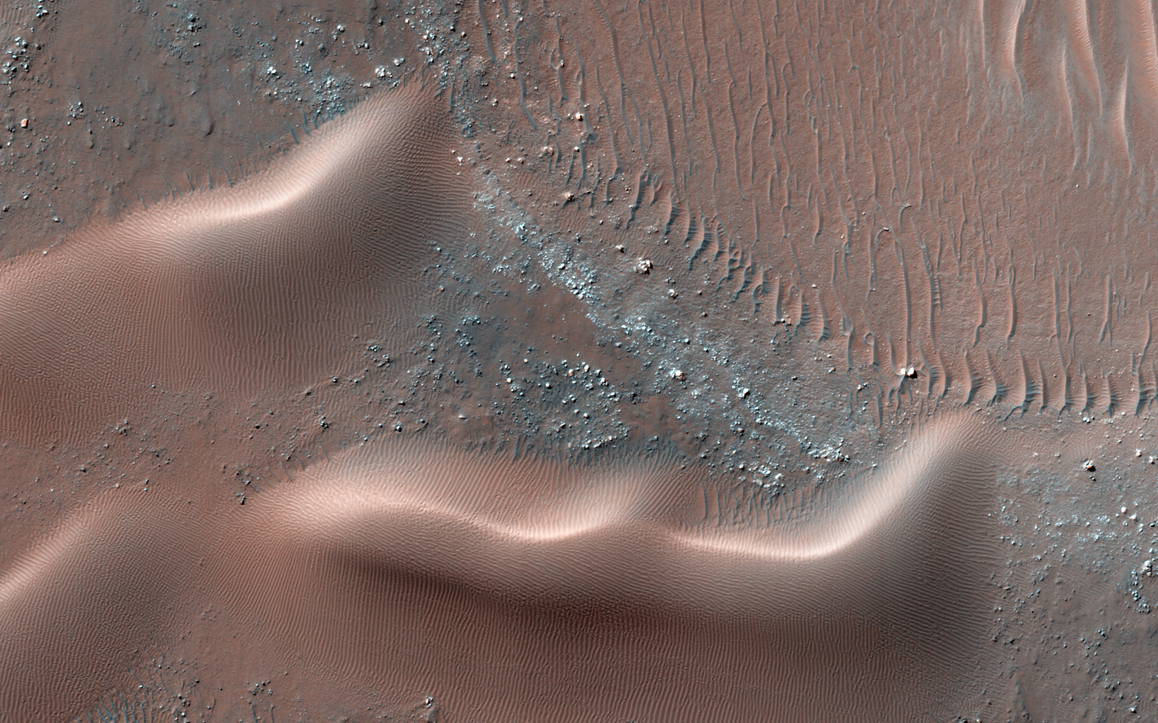 This observation from NASA's Mars Reconnaissance Orbiter is of one many that highlights new discoveries; one of these is that many sand dunes and ripples are moving, some at rates of several meters per year.