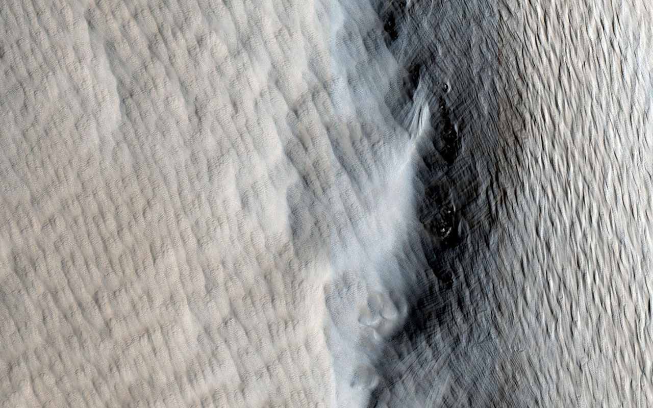 This image captured by NASA's Mars Reconnaissance Orbiter shows Tharsis Tholus, one of the smaller shield volcanoes on Mars' massive 'Tharsis Rise.'