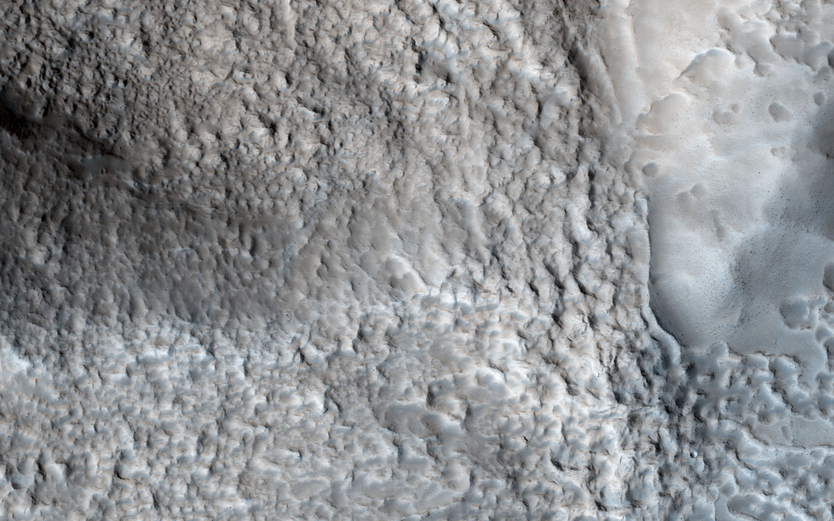 This image from NASA's Mars Reconnaissance Orbiter shows an impact crater with a diameter of approximately 2 kilometers located in the Coloe Fossae region of Mars.
