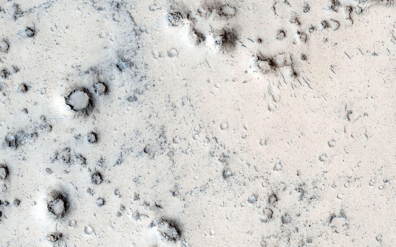Many types of craters exist on Mars. Most are generated by impacts of asteroids and comets. However, in this image captured by NASA's Mars Reconnaissance Orbiter, the craters may be due to steam explosions.