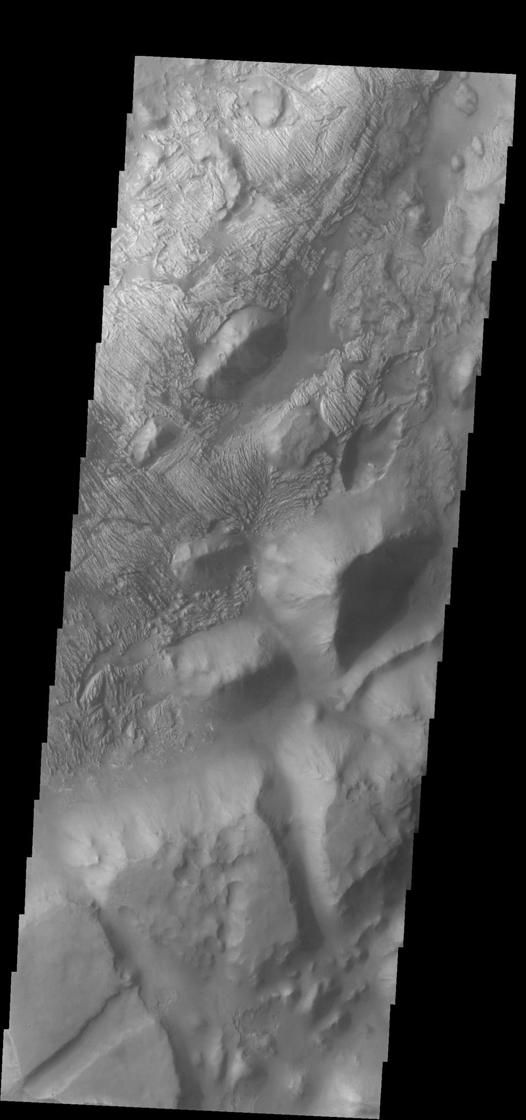 Several different surface textures are present on the lower elevations of Iani Chaos in this image from NASA's 2001 Mars Odyssey spacecraft.