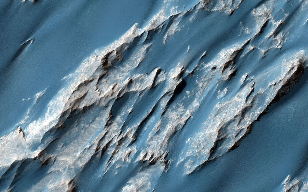 This image captured by NASA's Mars Reconnaissance Orbiter is of an ancient, approximately 3 billion year-old landslide shows two distinct surface albedos, which are proportions of reflected light.