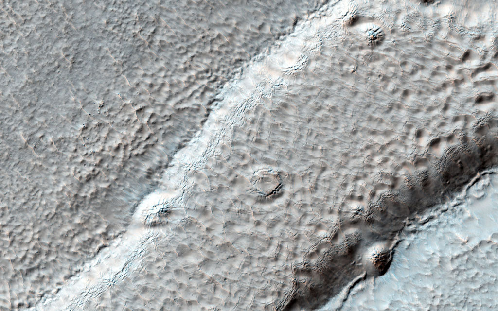Imaged by MRO's NASA's Mars Reconnaissance Orbiter Context Camera, this observation shows one of two odd, rounded mesas with a knobby, pitted texture.