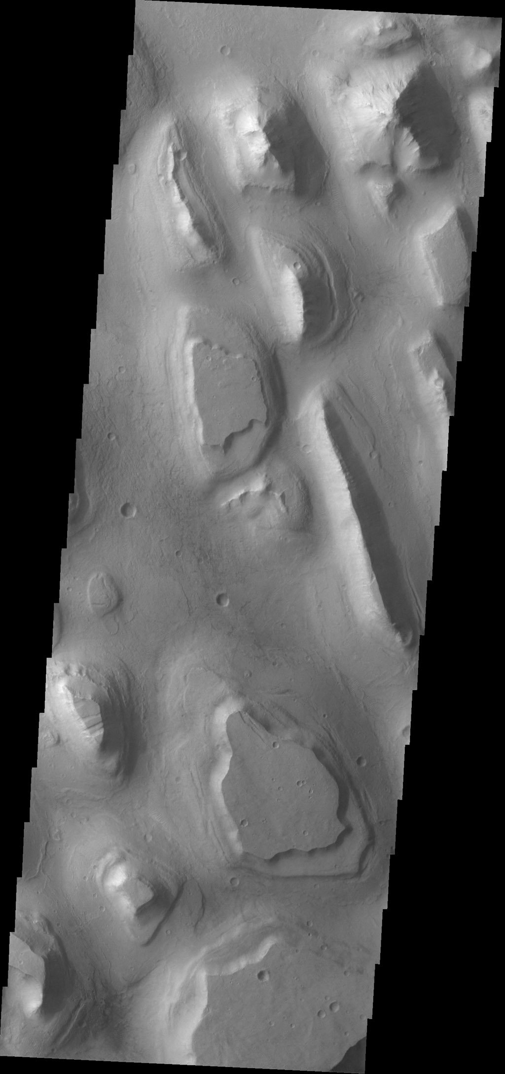 The ridges and mesas in this image captured by NASA's 2001 Mars Odyssey spacecraft are part of Hydraotes Chaos.