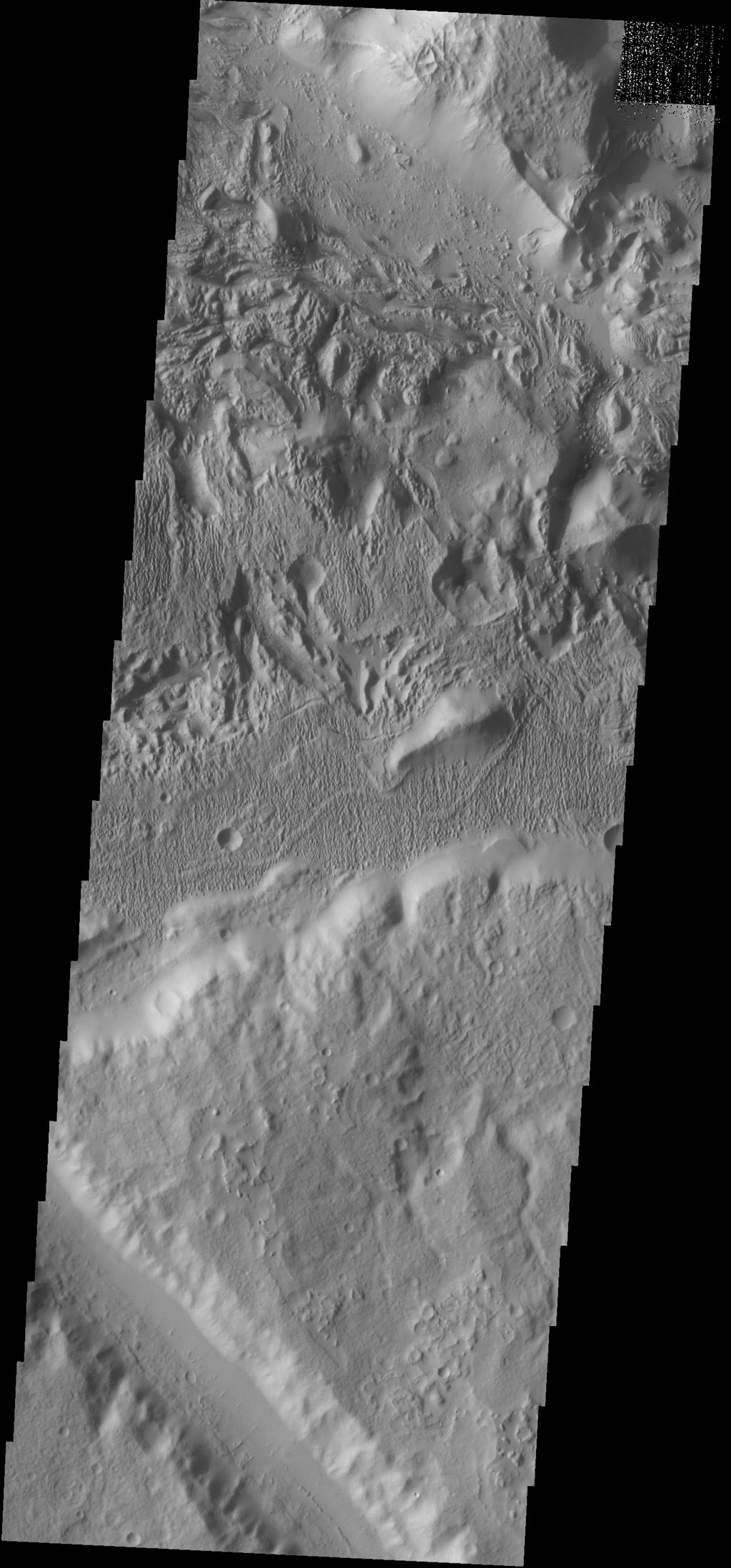 The surface textures located southeast of Aeolis Planum likely had wind action as one of the contributing processes, as shown by NASA's 2001 Mars Odyssey spacecraft.