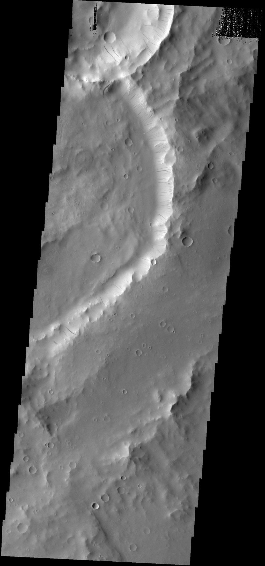 Dark slope streaks mark the inner rim of this unnamed crater in Terra Sabaea, as seen by NASA's 2001 Mars Odyssey spacecraft.
