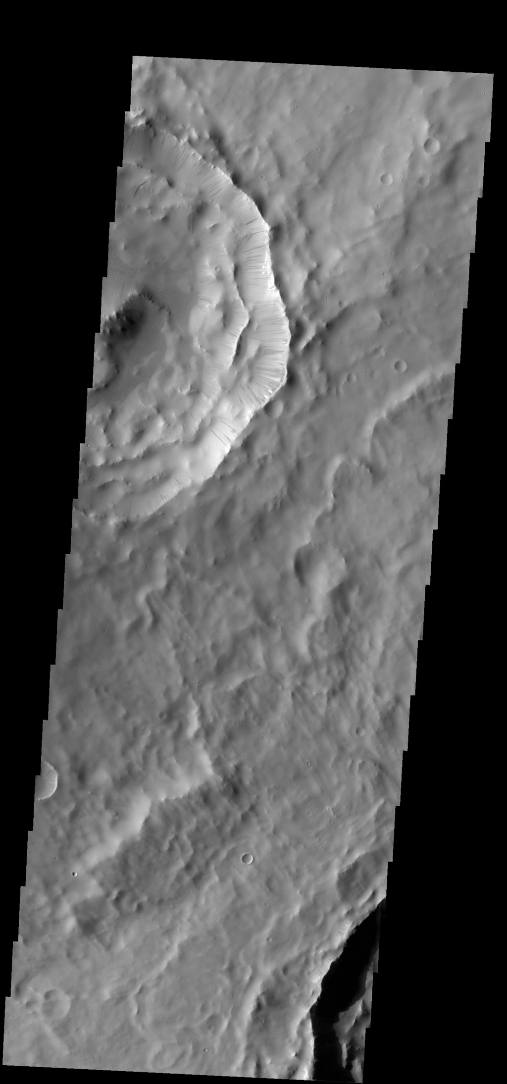 Numerous dark slope streaks are located on the inner rim of this unnamed crater in Terra Sabaea. This image is from NASA's 2001 Mars Odyssey spacecraft.