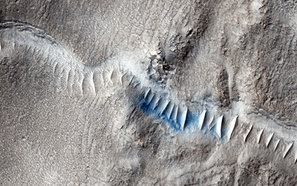 This observation from NASA's Mars Reconnaissance Orbiter shows enigmatic, shallowly incised valleys, found in some mid- to low-latitude regions on Mars.