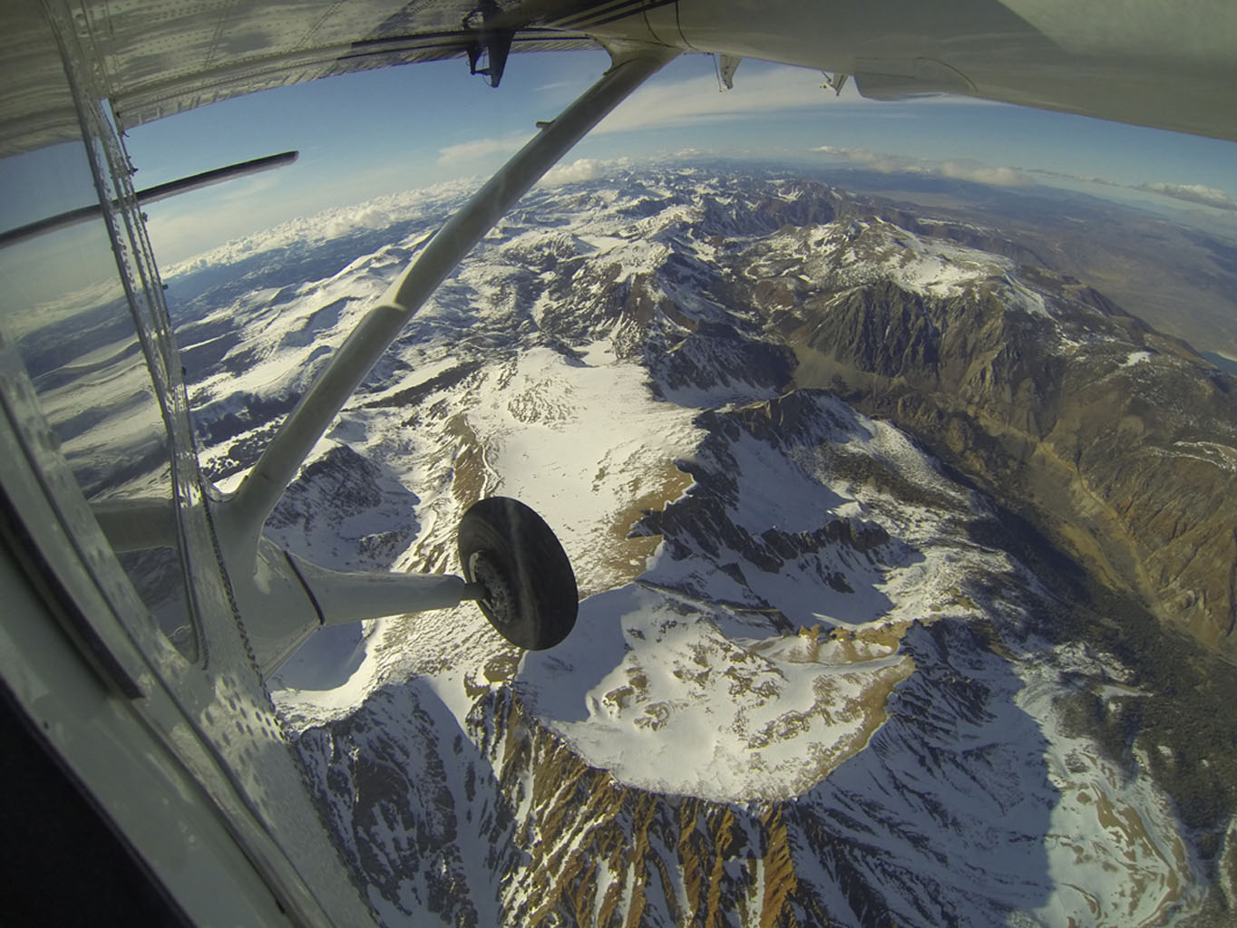 Mt. Dana and Dana Plateau in the Tuolumne River Basin within Yosemite National Park, Calif., as seen out the window of a Twin Otter aircraft carrying NASA's Airborne Snow Observatory on April 3, 2013.