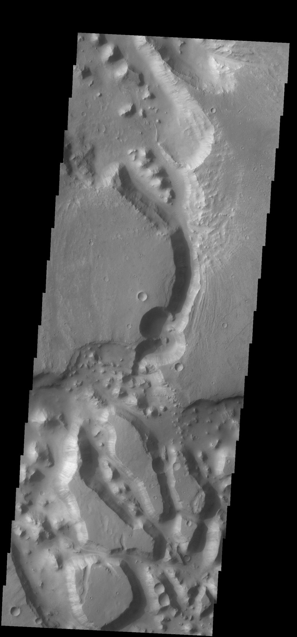 This complex region of channels and chaos is located south of Chia crater and east of the much larger Maja Valles. This image was captured by NASA's 2001 Mars Odyssey spacecraft.