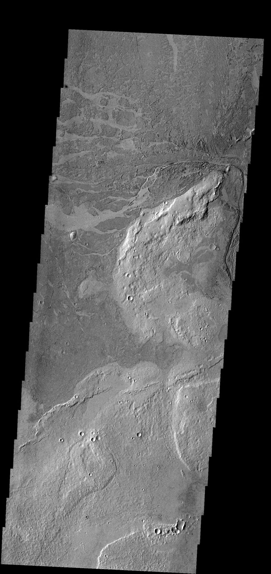 This image near Athabasca Valles shows thin plate of lava as seen by NASA's 2001 Mars Odyssey spacecraft. This style of lava flow is very different from other lava flows in the nearby Elysium and Tharsis volcanic complexes.