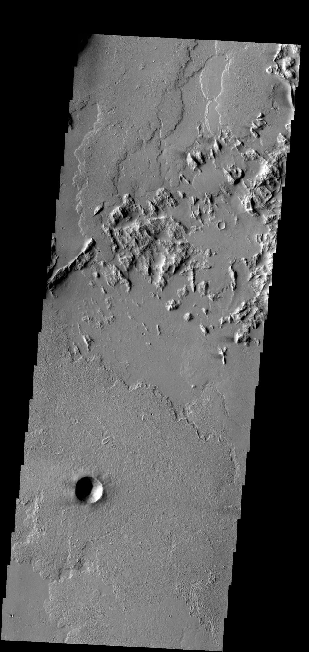 This image captured by NASA's 2001 Mars Odyssey spacecraft is located southwest of Olympus Mons, shows the end of a lava flow that has flowed between the hills at the upper left portion of the image.