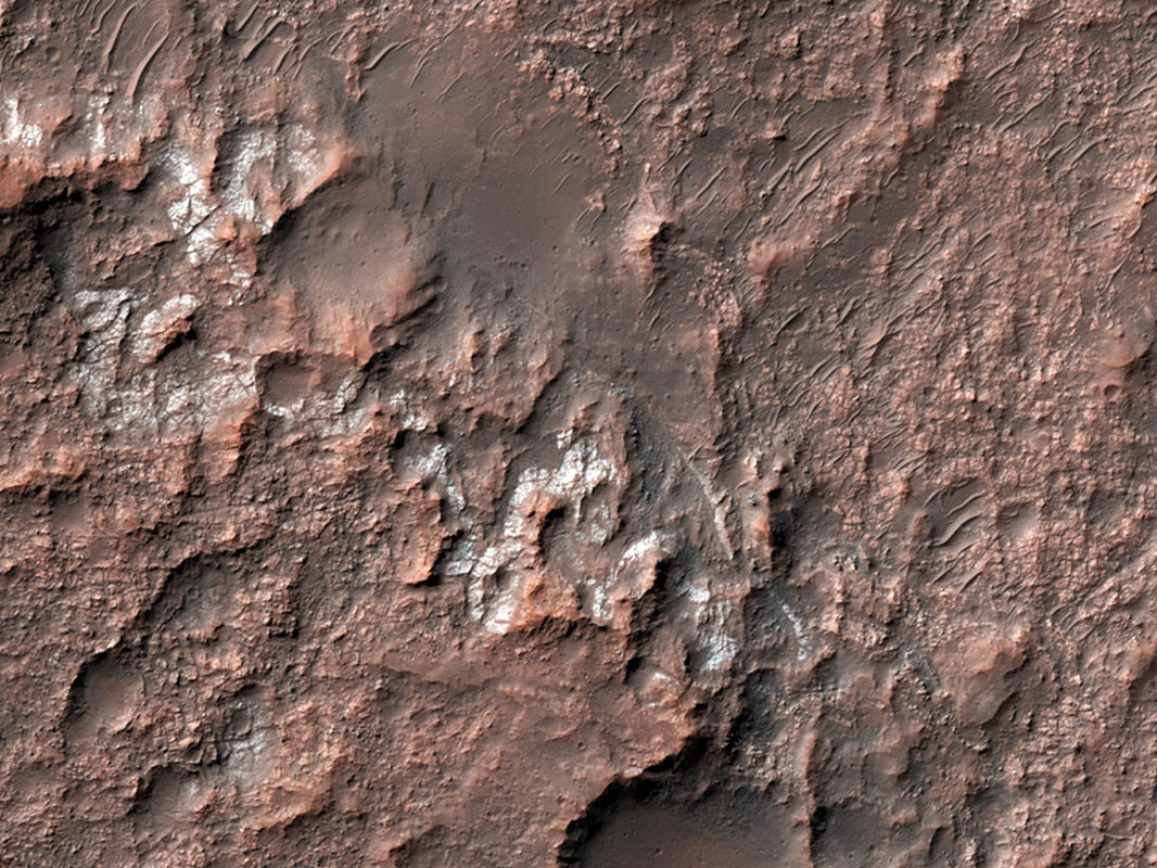 This image from NASA's Mars Reconnaissance Orbiter shows chlorides that have a bright appearance and are covered by other dark materials.