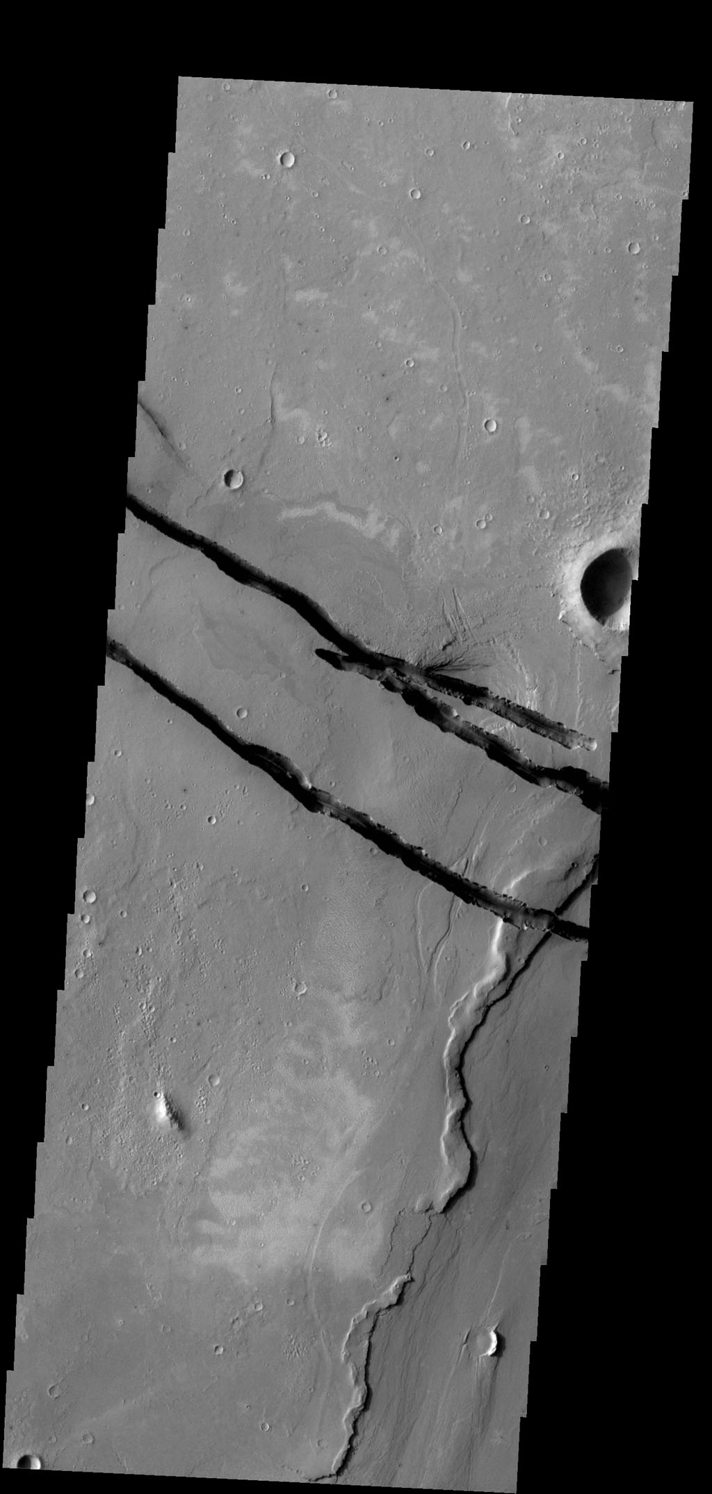 The fractures in this image are part of a large system of fractures called Cerberus Fossae. Athabasca Valles is visible in the lower right corner of the image as seen by NASA's 2001 Mars Odyssey spacecraft.