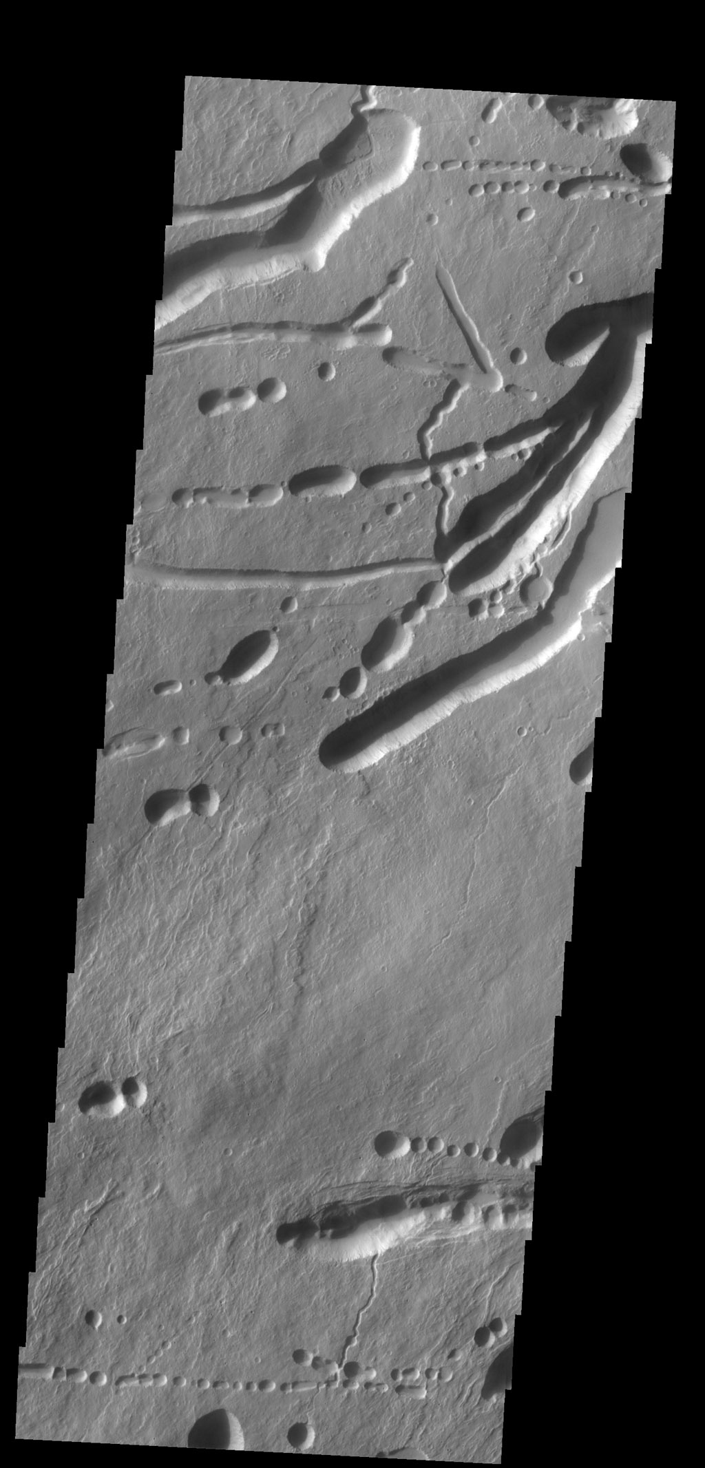 This image shows a different portion of the collapse features located on the northern flank of Ascraeus Mons as seen by NASA's 2001 Mars Odyssey spacecraft.