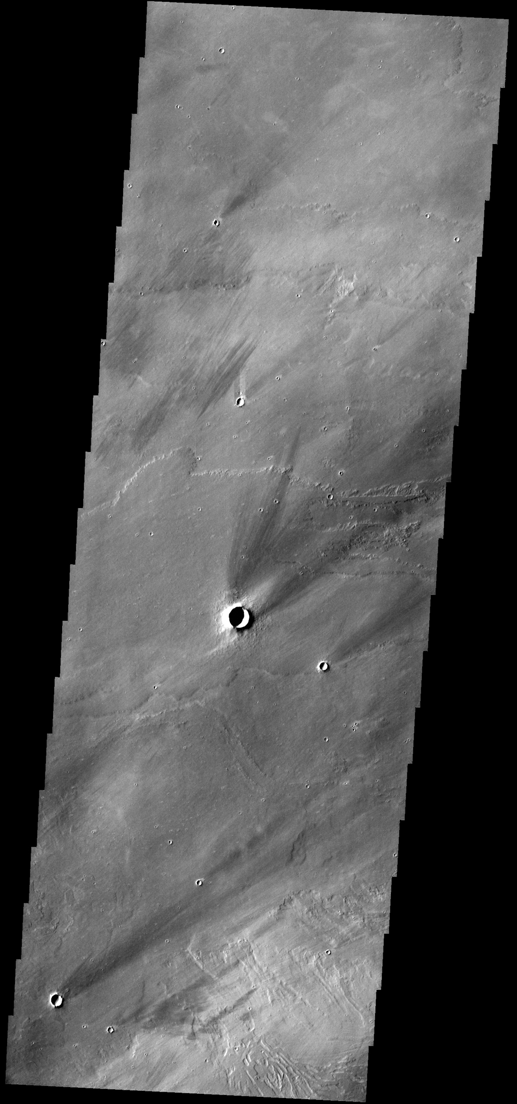 The windstreaks in this image from NASA's 2001 Mars Odyssey spacecraft are located on the lava plains between Pavonis Mons and Noctis Fossae.